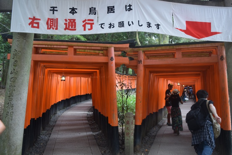 Visitors begin their trek through Fushimi Inari through the left tunnel of torii gates. | Photo by Alexandra Pamias