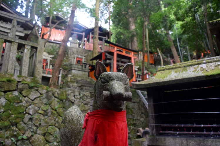 A stone fox statue of the kami Inari found all over the shrine. | Photo by Alexandra Pamias
